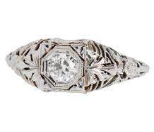 Feminine Solitaire Diamond Ring