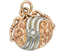 Spinning Platinum and Rose Gold Diamond Locket